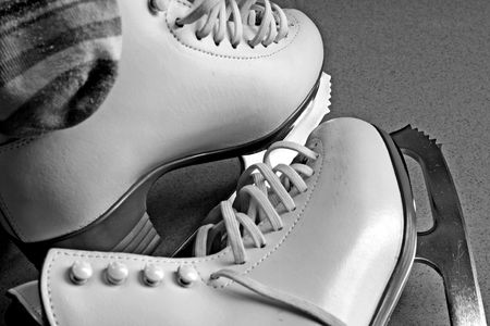 grayscale: A pair of white skating boots rendered in grayscale.