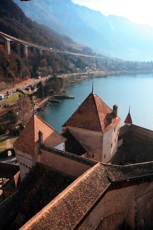 View from the tower of Chillon Castle overlooking Lake Geneva on a misty morning. Stock Photo