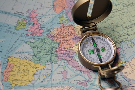 A compass on the map of the European continent.  Stock Photo