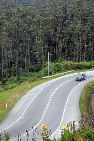 pahang: A 4WD vehicle traveling down the winding roads of Cameron Highlands, in Pahang, Malaysia.  Stock Photo