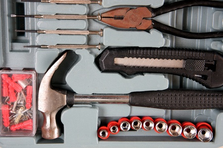 neatly: Work tools arranged neatly in a toolbox. Stock Photo