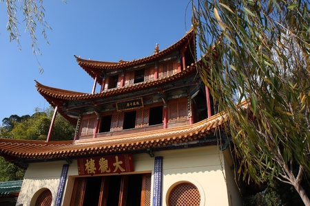 Ancient Chinese architecture against the blue sky in Kunming, China.