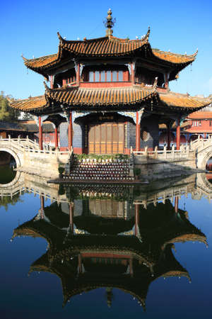 An ancient building in the courtyard of an old Chinese temple in Kunming, China.
