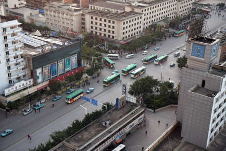 KUNMING - DECEMBER 6, 2010  Rush hour in the morning as commuters travel to work on December 6, 2010 in Kunming, China  Kunming is the largest city in Yunnan Province of China  Editorial