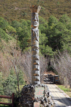 A Naxi tribe totem pole carved out from wood at Dongba Valley, in Lijiang, Yunnan Province of China