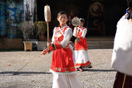 LIJIANG, CHINA - DECEMBER 8, 2010  Unidentified Naxi ethnic dancers perform at Dongba Valley Cultural Village, on December 8, 2010 in Lijiang, Yunnan Province of China  The Naxi indigenous people are one of the largest ethnic groups in Lijiang