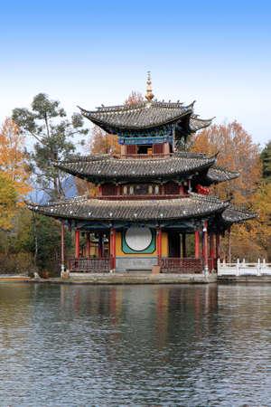 A Chinese pagoda in the lake of Black Dragon Pool in Lijiang, Yunnan Province of China