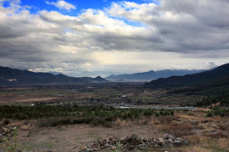 View from a hill in Lijiang, Yunnan Province of China, overlooking the vast plateau of Dongba Valley   Stock Photo