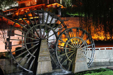Night scene of the watermills at Lijiang Old Town, Yunnan Province of China   photo
