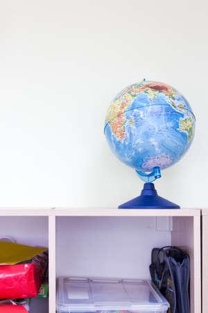 Globe on shelve in school