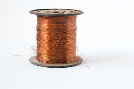 Copper wire on spool, isolated on white backgrounds, with clipping paths on white background