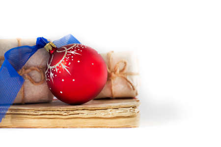 gift books and christmas ball, holiday composition on white background