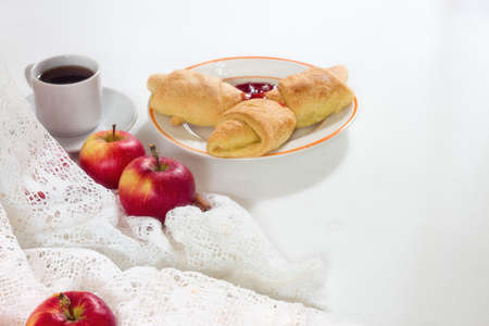 delicious apples, cup of coffee, croissant on the white wooden background 版權商用圖片