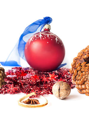 Christmas background. red balls, pine cones and berries on white background. copy space. Vertical.