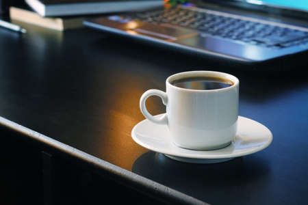 Coffee for work with laptop background