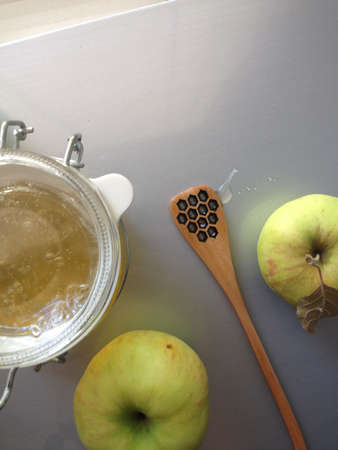 flat lay honey apple and spoon on light background