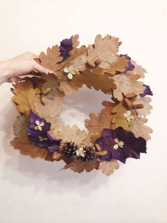 wreath of leaves in hand