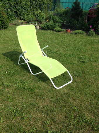 chaise lounge on a grass in the summer in a country house