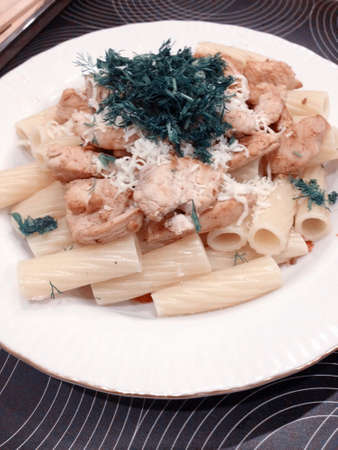 food on a plate pasta with hen