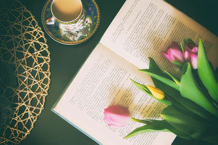 Vintage books with bouquet of flowers nostalgic vintage background