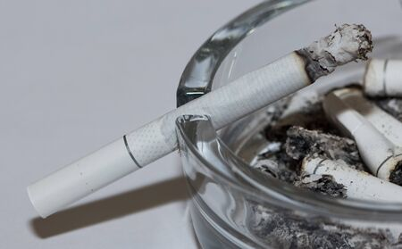Photos of harmful substances and cigarettes