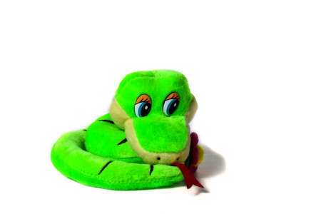 Soft toy small green striped smiling snake isolated on white background. The concept of wisdom and humor