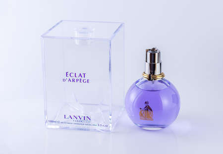 Chelyabinsk, Russia, December 23, 2019. Lanvin Eclat D'arpege perfume transparent bottle with packing box on a white background 100 ml. Lanvin Brand is a manufacturer of perfume products in Paris.