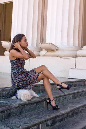 Girl with legs crossed Stockfoto