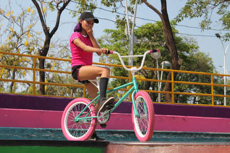 Girl riding bicycle in the park