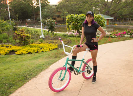 Girl posing on a bicycle