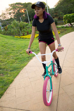 Woman learning to ride a bicycle