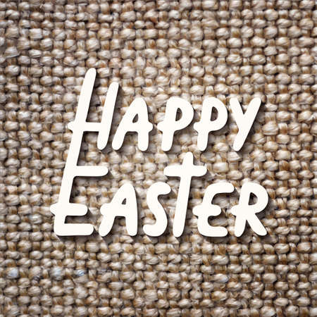 Happy Easter vector typography design elements for greeting cards, invitation, prints and posters. Hand drawn lettering on sacking linen texture background, modern calligraphy style