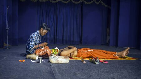 KOCHI (Cochin), INDIA - OCTOBER 1 , 2018: Performers applying makeup.