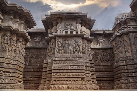 India Belur temple. Old stone wall with sculptures. Stock Photo