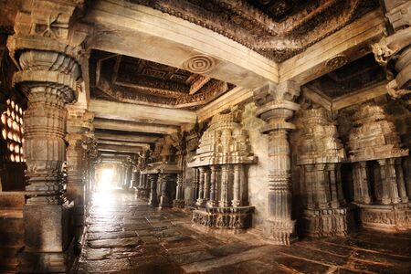 India Belur temple. Old stone wall with sculptures. Editorial