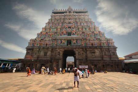 India Kanchipuram January 10, 2018: Pilgrims walk near the front gate of the temple Editorial