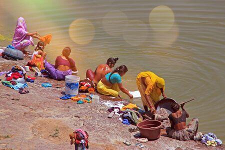 India Hampi - 2017 31 december: Women wash clothes in a rural river