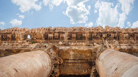 Ancient stone columns of Temple of Bacchus in Baalbek, Lebanon. Old Roman ruins landmark of Baalbek. Lebanon tourist travel site.
