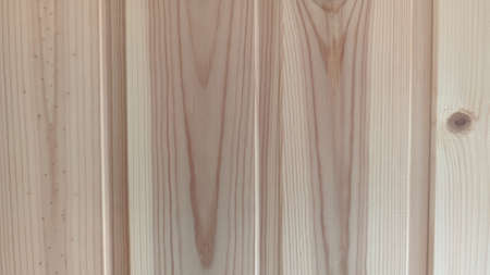 Fragment of a wall of vertical treated pine boards, close-up Reklamní fotografie