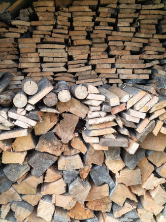 Woodpile for a fire, made of pine and birch boards