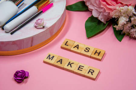Composition of tools for eyelash extensions, inscription Lashmaker 免版税图像