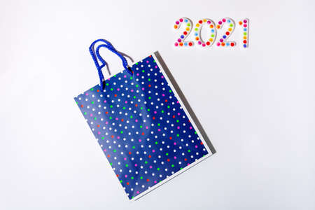 Happy New Year 2021. Symbol from number 2020 on white background and gift package 免版税图像