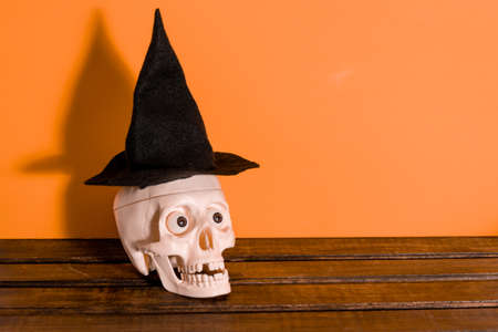 Happy Halloween. Skull in a hat on a yellow background. the concept of Halloween