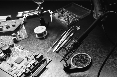 soldering iron repair work. black and white photo