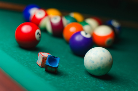 snooker halls: Billiard balls in a green pool table, game