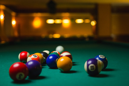 snooker halls: Billiard balls in a pool table. game