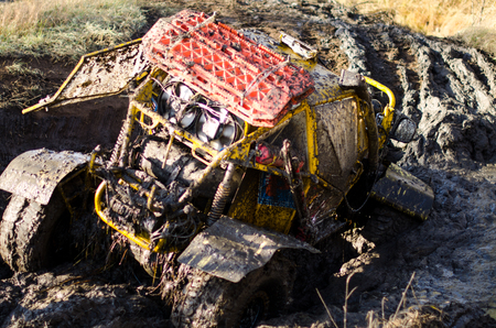 Off-road car in a puddle making mud splashes. competiton in Kazakhstan