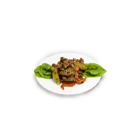 Veal with vegetables. juicy slices of veal with grilled vegetables under a spicy sauce, sesame emphasizes a symphony of aftertaste