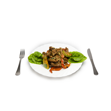 Veal with vegetables. juicy slices of veal with grilled vegetables under a spicy sauce, sesame emphasizes a symphony of aftertaste on the white plate isolated Stock Photo