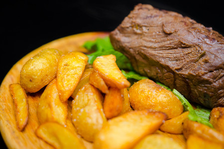 Tender and juicy veal steak medium rare with French fries. Stock Photo